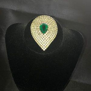 Faux diamond emerald brooch.